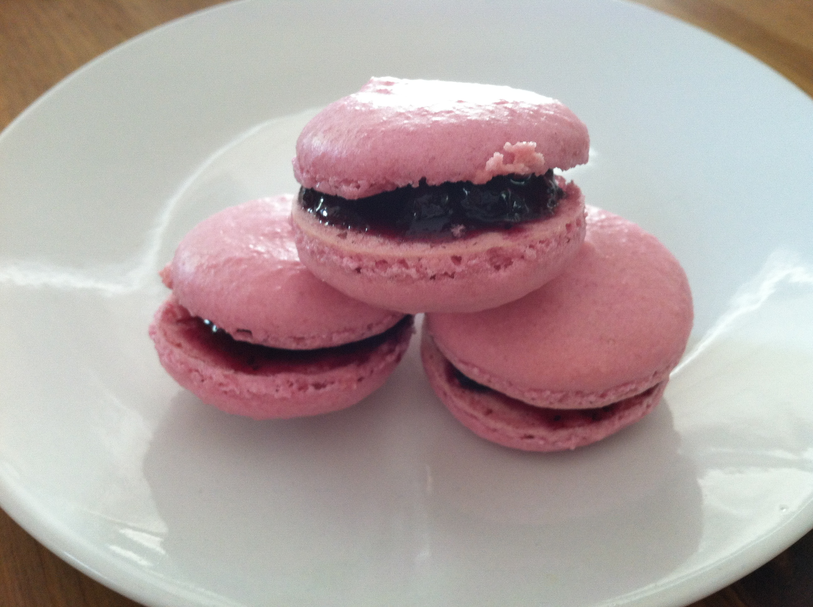 French Parisian Macaroons stuffed with raspberry jam